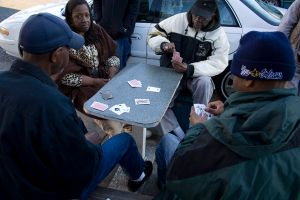 Sidewalk card game on Dryades Street, Central City New Orleans. Derek Bridges